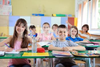 stock-photo-10100880-children-sitting-in-classroom-.jpg