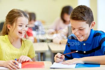 stock-photo-57345942-group-of-school-kids-writing-test-in-classroom.jpg