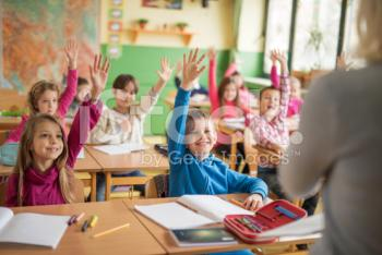 stock-photo-69014059-school-children-raising-their-hands-ready-to-answer-the-question-.jpg